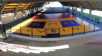Installation d'un sol de jeu en PVC sous le dôme du stade Vanterpool